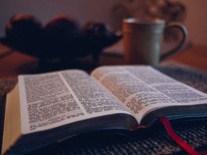 New Bible open on table