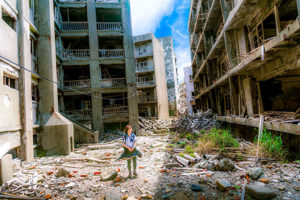 girl stands amid destruction