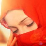 Sad woman veiling her face