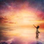 Woman praises God under the night sky