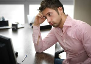 frustrated man at the office