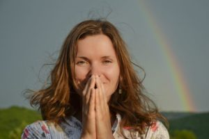 grateful, happy woman; rainbow in background