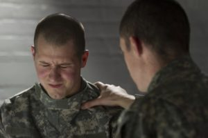 Soldier consoles peer with PTSD