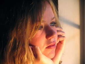 woman crying, gazing out window