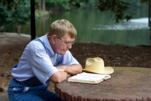Man having his quiet time at a peaceful outdoor spot