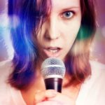 nervous girl singing with microphone