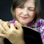 Woman adoringly reading Bible